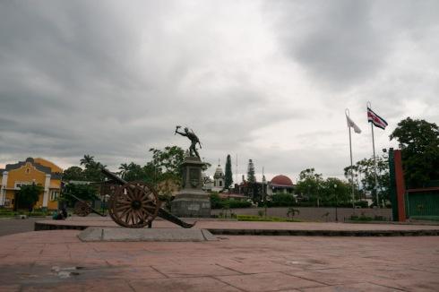 Alajuela canon, statue of Juan Santamaría (the national hero), flags