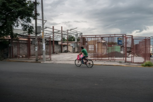 Alajuela. Man on a bicyle. Catchy colours.