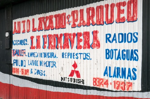 Hand painted advertisement on corrugated iron
