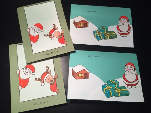 Christmas cards with Santa and reindeer; and with Santa, presents and little cabin