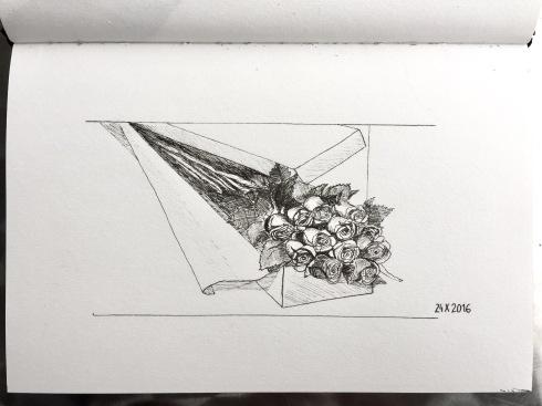 A dozen roses in a gift box.
