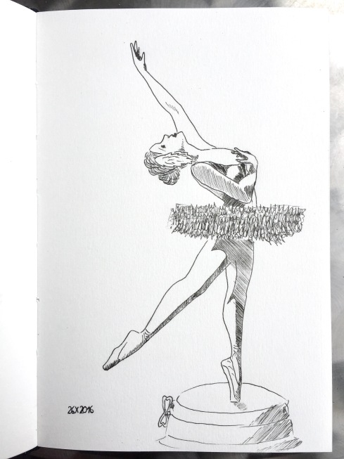 Black ink drawing of a ballerina on a music box