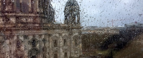 Raindrops on window, some landmark or building across the street