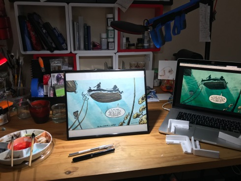 Photo of the framed painting on my desk between the palette and the computer displaying the reference picture.